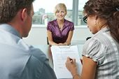 stock photo of interview  - Conductors holding questionnaire form during the job interview - JPG