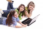 stock photo of sissy  - Girls with a laptop - JPG