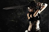 stock photo of pirate sword  - Beautiful female fighter with a sword in her hands - JPG