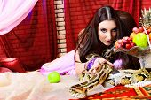 stock photo of concubine  - Shot of an oriental woman posing with a python - JPG