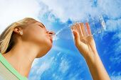 foto of drinking water  - Beautiful blond girl drinking water - JPG
