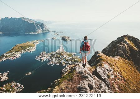 poster of Man Traveler Hiking On Reinebringen Mountain Ridge In Norway Lifestyle Adventure Traveling Outdoor S