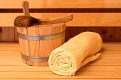 Detail Of Bucket And Yellow Towels In A Sauna poster