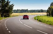 Car On Black Asphalt Road In Beautiful Spring Day At Countryside poster