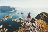 Man Traveler Hiking On Reinebringen Mountain Ridge In Norway Lifestyle Adventure Traveling Outdoor S poster