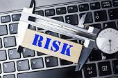 Risk Assessment Or Measuring The Risk Concept With High Precision Caliper Tool On Laptop Keyboard poster