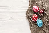 Stylish Easter Flat Lay. Painted Eggs On Rustic Wooden Background With Spring Willow Branches. Happy poster