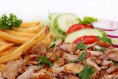 Gyros with french fries and vegetables