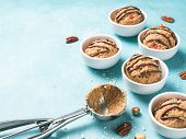 Safe-to-eat Raw Monster Cookie Dough In Small Portion Bowl, Ice Cream Scoop And Nuts On Blue Backgro poster