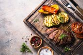 Grilled Beef Steak And Grilled Vegetables On A Wooden Serving Board. Barbecue Dish. Top View With Co poster