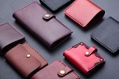 Set Of Hand Made Leather Man Wallet . Multi Colored. Leather Craft.on Dark Background.top View poster