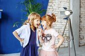 Two Little Funny Children Sing A Song In A Microphone. Group. The Concept Is Childhood, Lifestyle, M poster