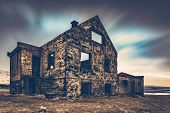 Old damaged house, ruins of building on the wasteland, weathered and abandoned home in Iceland, Scan poster