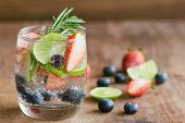 Infused Water Made From Blueberry Strawberry And Lemon In Sparkling Mineral Water Look So Freshness  poster