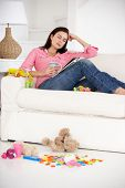 stock photo of untidiness  - Exhausted mother enjoying a rest - JPG