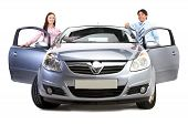 pic of luxury cars  - happy couple with their new car isolated over a white background - JPG