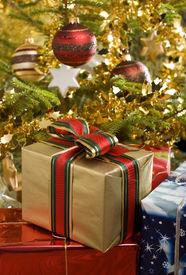 stock photo of christmas dinner  - christmas gifts under christmas tree close up - JPG