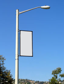image of lamp post  - a blank promotional banner on a streetlight post - JPG