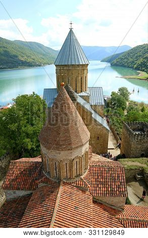 poster of Two Historic Churches On The Aragvi River Bank Inside Ananuri Fortification, Historical Place In Geo