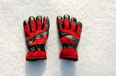 High Angle View Of  Red  Pair Of Winter Ski Gloves On Snow poster