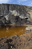 image of pyrite  - acidic waters in pyrite smelting landfill in Riotinto Spain - JPG