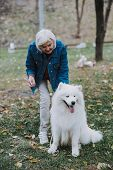 Adult Woman With Her Cute Pedigree Dog Outside poster