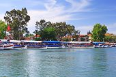 picture of dalyan  - Pleasure boats on Dalyan river near Lycium tombs Turkey - JPG