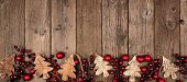 Christmas Border Banner With Wood Tree Decorations And Red Baubles. Above View On An Aged Wood Backg poster