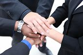 picture of business-partner  - A diverse group of workers with their hands together in form of teamwork - JPG