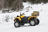 Quad Vehicle In The Snow. All-terrain Vehicle. poster