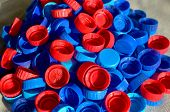 Plastic Bottle Caps Background. Cap Material Is Recyclable.remove Lids From Plastic Bottles Before R poster