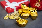 New Year Gift, Red Pouch Money Bag, Chinese Gold Coins And Gold Ingots With Chinese Character Meanin poster