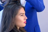 Face Of Young Woman In Beauty Salon On Hairstyle With Hairdresser, Side View. Glamour Fashion Indust poster