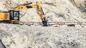 Industry. Heavy Duty Excavator Machine, Digger Bulldozer Working On Stone Construction Site, Norway  poster