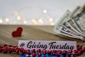 Giving Tuesday Donate Charity Concept With Text And Cash On Wooden Board poster