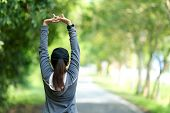 Healthy Woman Warming Up Stretching Her Arms. Asian Runner Woman Workout Before Fitness And Jogging  poster