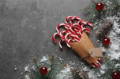 Flat Lay Composition With Candy Canes And Christmas Decor On Grey Background poster