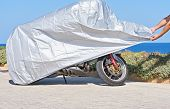 Biker Covers Motorcycle With Waterproof Cover With Silver Reflective Surface Protective. Motorbike C poster