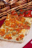 picture of nic  - Typical italian focaccia bread with cherry tomatoes on top - JPG