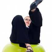 Businesswoman Falling Down From Exercise Ball