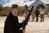 foto of gunfighter  - Brave old west cowboy under attack from outlaws - JPG
