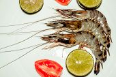 Three Fresh Uncooked Shrimps With Limes, Tomatos On White Plate. Raw Prawns Closeup. Healthy Delicio poster