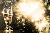 two champagne glasses with ribbons against holiday lights and fireworks - New Year celebrations poster