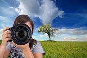 Young Female Photographer With Digital Photo Camera Shooting Landscape Scene