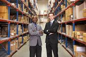 pic of warehouse  - Portrait Of Two Businessmen In Warehouse - JPG