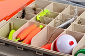 pic of fishing bobber  - Messy fishing tackle box with hooks - JPG