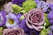 pic of centerpiece  - Mixed purple flowers in a wedding centerpiece - JPG