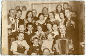 LODZ, POLAND - CIRCA FORTIES: a big unidentified three-generation family poses for a photo during a