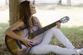 Cute girl playing a guitar
