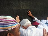 MECCA - MAY 23 : A close up view of Muslim pilgrims praying at the Kaaba from ground floor of Haram